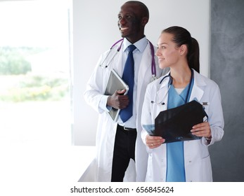 Doctors analyzing an x-ray in a meting. Doctors