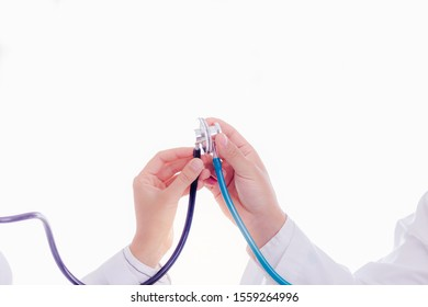Doctors celebrating by using, touching their stethoscopes, doctor woman and doctor man gets successful for cured or heal their patient. They are good teams, collaborating, congratulating together
