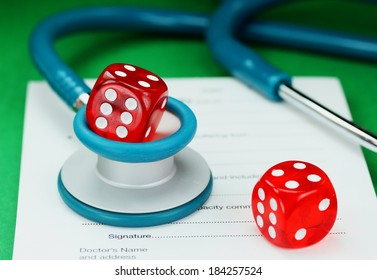 A Doctors desk with a dice placed on top of a blue stethoscope, with another dice placed on a doctors sick certificate pad, asking the question, do you gamble with your health
