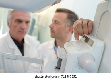 doctors discussing next to mri machine in hospital