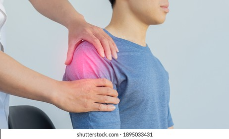 The doctor's hand gripped the shoulder of a painful young man with red dots.