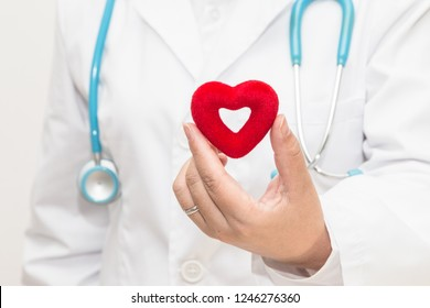 Doctor's hand holding a heart shape