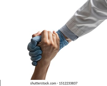 A doctor's hand saving the patient on white isolated background. Concept of salvation, donorship, helping hand.