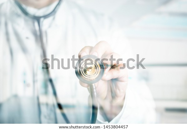 Doctor's hand with stethoscope background
