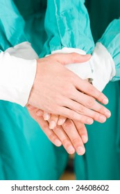 doctors with hands together to form a medical teamwork