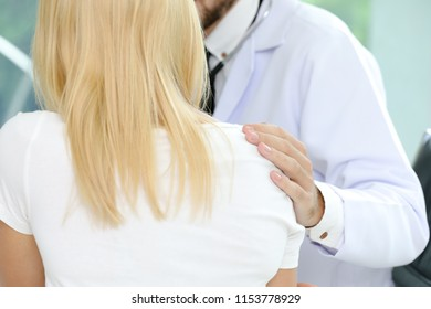 Doctor's hands touch femal patient to encourage in the hospital. Comfort hands of professional doctor. Partnership, trust and medical ethics concept. Bad news listening.