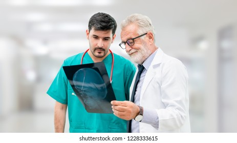 Doctors at hospital working with another doctor. Healthcare and medical people services concept.
