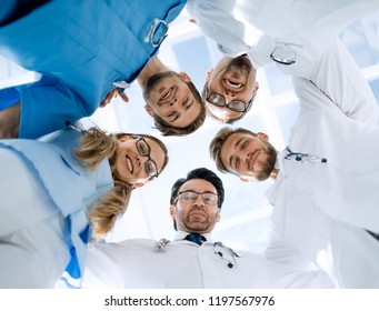 doctors looking down smiling at the camera