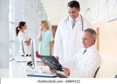 Doctors looking at radiography in hospital