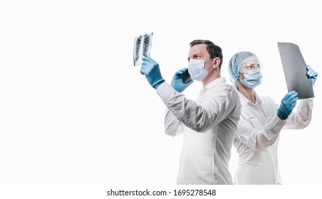 doctors man and woman on a white background in medical masks on the face