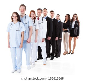 Doctors and managers standing in row. Isolated on white