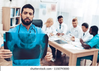 Doctor's Meeting. Diagnostic Discussion. Multinational Medicals. Professional Consultation. Patient's Test. Latine Specialist With X-ray Results. Clinician Team Group. Physician Assistants.