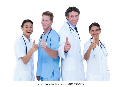 Doctors and nurse gesturing thumbs up on a white background