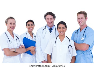 Doctors and nurse standing together on a white background