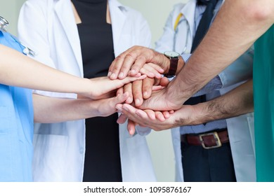 Doctors and nurses coordinate hands teamwork. Successful work and trust in teamwork at hospital
