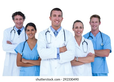 Doctors and nurses standing together with arms crossed on a white background