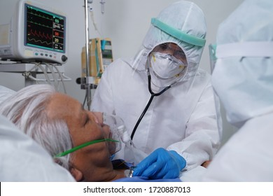 Doctors and nurses are working hard to treat corona virus/covid-19 infected patients in the ICU/ hospital.