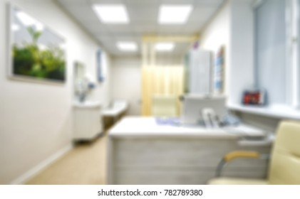 Doctor's office as creative abstract blur background. Light interior of doctor's office in modern clinic. Blurred image of cabinet or room for medical concept.