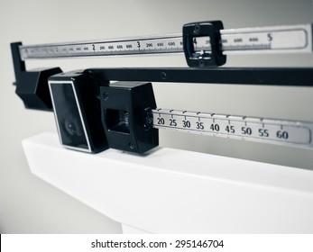 Doctor's Office Scale - Medical professional physician sliding balance weight scale at a doctor's office