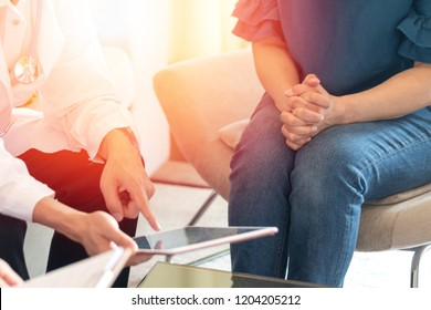 Doctors and patient healthcare concept. Gynecologist physician team consulting and examining woman patient health in Obstetrics and Gynecology department in medical hospital health service center.