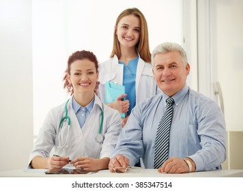 Doctors and patient in office