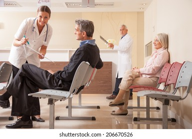 Doctors and patients in hospital waiting room.