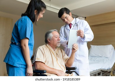 Doctors and physical therapists are caring for elderly sick people. Doctor and nurse taking care of elderly patient at hospital room. elderly patient using tablet.