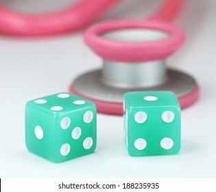 A Doctors Pink stethoscope with two aqua colored dice with black spots dice placed next to it, asking the question, do you gamble with your health.