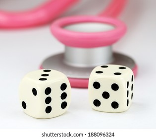 A Doctors Pink stethoscope with two white dice with black spots dice placed next to it, asking the question, do you gamble with your health.