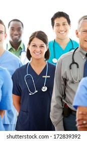 Doctors: Pretty Doctor In Middle Of Large Group