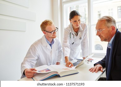 Doctors with senior patient in consultation about therapy