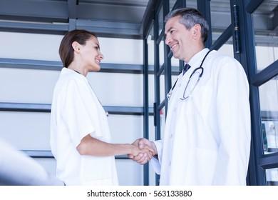Doctors shaking hands in hospital