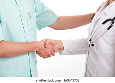 Doctors are shaking hands to say thank you for good teamwork