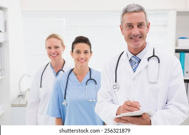 Doctors smiling at camera in medical office