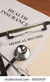 Doctor's stethoscope, medical record and health insurance document. Concept of healthcare.