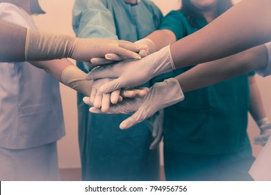 Doctors surgeon and nurses with surgeon medical people handshaking or  coordinate hands, Concept coordinate hands Teamwork.