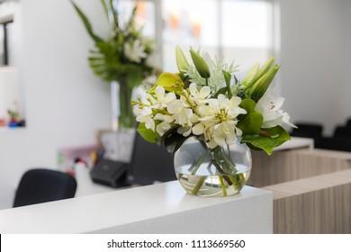Doctors surgery reception desk flowers
