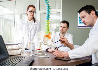 Doctors team having medical council in hospital. Discussing medical issues. Spine fixation systems. Spinal surgery