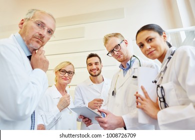 Doctors thinking about medical problem in cooperation with physicians