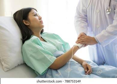 Doctors  touching  hand encourage patients in the hospital - medical and healthcare concept