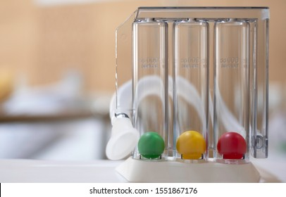 Doctor's tri-ball incentive spirometry in hospital. The Tri-ball incentive spirometry is medical equipment for elderly or patient with post operation. Lungs function testing & Pulmonary test concept.