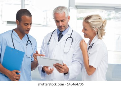 Doctors using a tablet in hospital