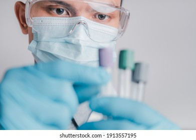 Doctors wear masks and glasses, scientists hold syringes and vaccines. Vaccination and laboratory experiments, COVID-19 virus protection concept, vaccine invention and production concept.