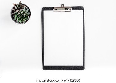 doctor's work desk in hospital with sketch-board white background top view mockup
