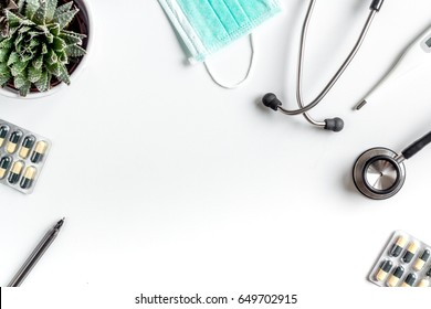 doctor's work desk in hospital with stethoscope and pills white background top view mockup