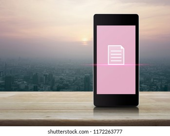 Document flat icon on modern smart mobile phone screen on wooden table over city tower and skyscraper at sunset, vintage style, Business communication online concept