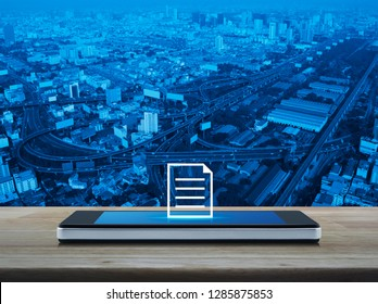 Document flat icon on modern smart mobile phone screen on wooden table over city tower, street, expressway and skyscraper, Business communication online concept