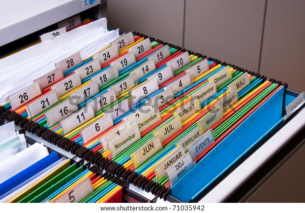 Document folders sorted for archive with colors and numbers