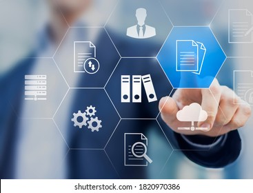 Document Management System (DMS) used to store, search and manage review process and users for corporate files and information in enterprise. Concept with business manager pointing to icons. - Shutterstock ID 1820970386