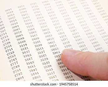 document with many numbers, data encrypt. Cipher encryption code or data, closeup